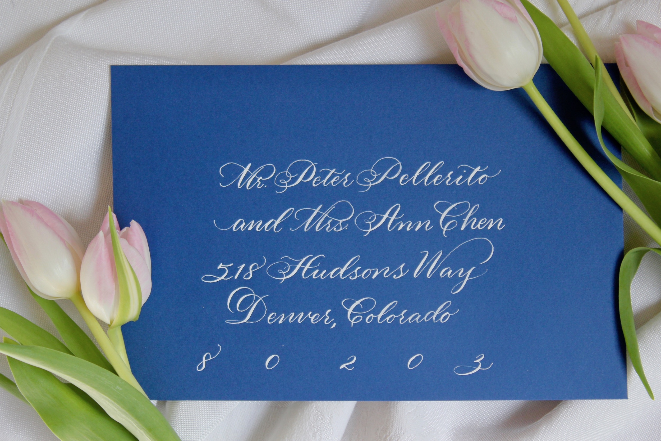 Leah E Moss - blue envelope white classic calligraphy