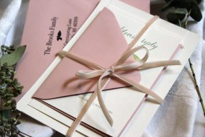 Wedding invitation with blush envelope and velvet ribbon