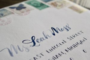 navy brush lettering with vintage stamps