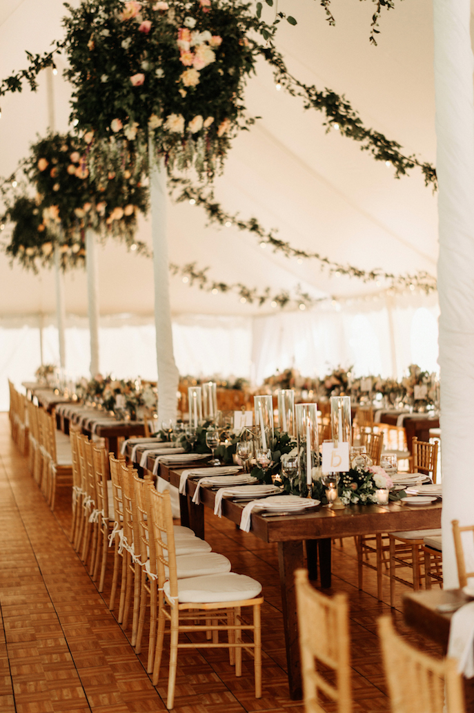 Farmhouse Chic Wedding - long table with greenery - Leah E Moss