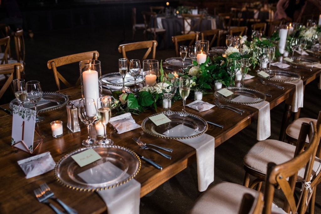 farmhouse table with garland and candles