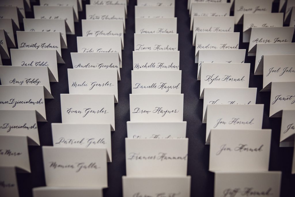 Escort cards in navy modern calligraphy - Leah E. Moss Designs