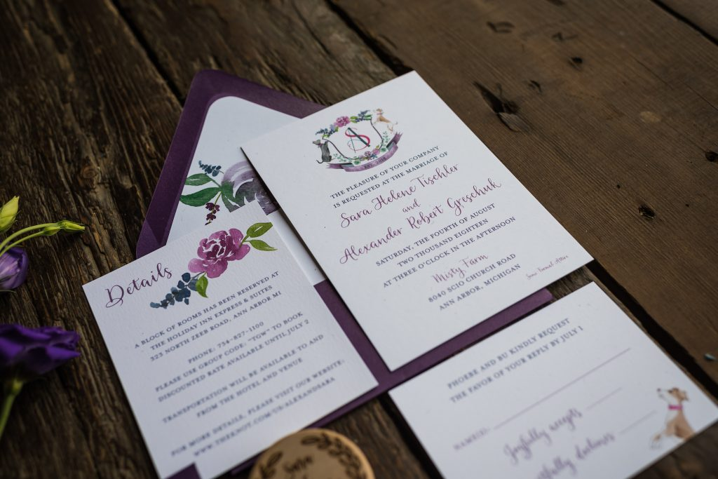 Wedding invitation with purple crest, animals, florals, modern calligraphy - Leah E. Moss Designs