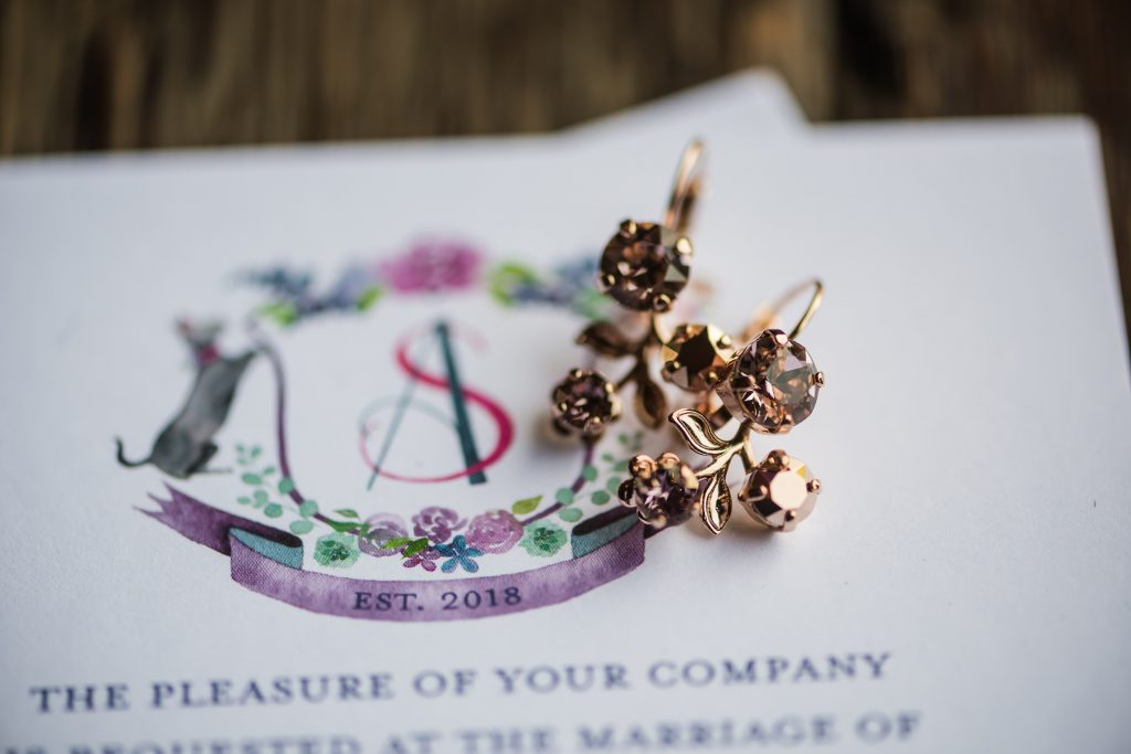 Purple wedding crest with dog, cat, and florals - Leah E. Moss Designs