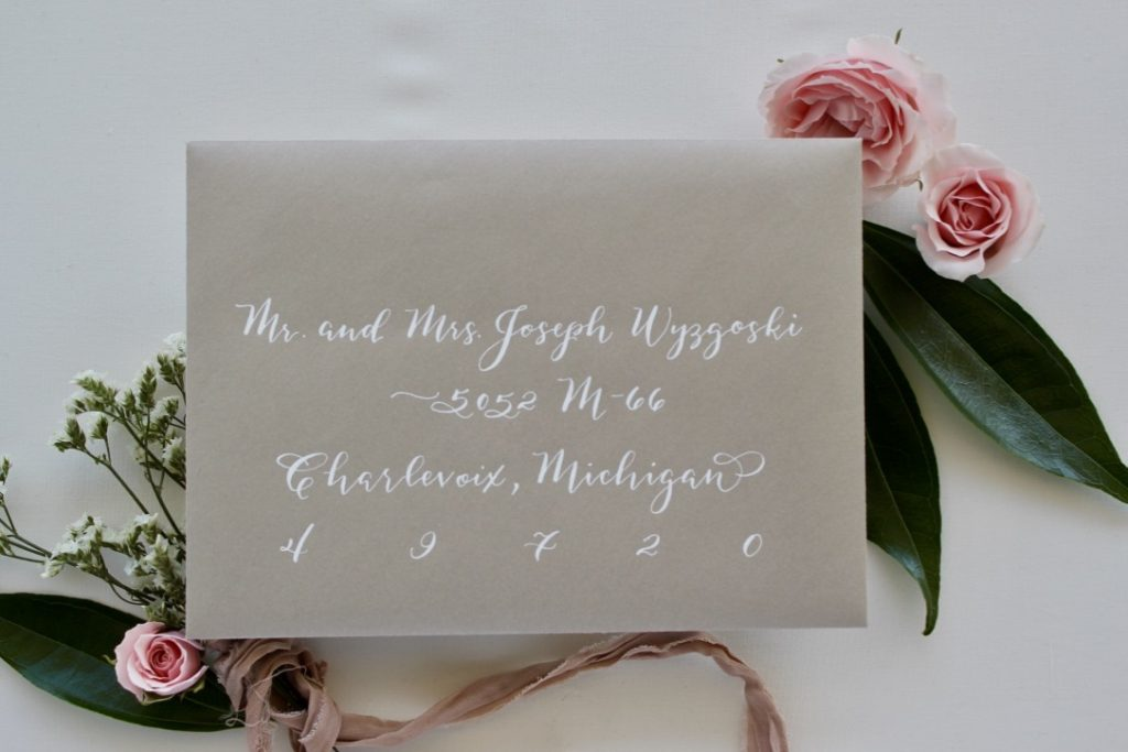 Champagne envelope with white calligraphy - Leah E. Moss Designs