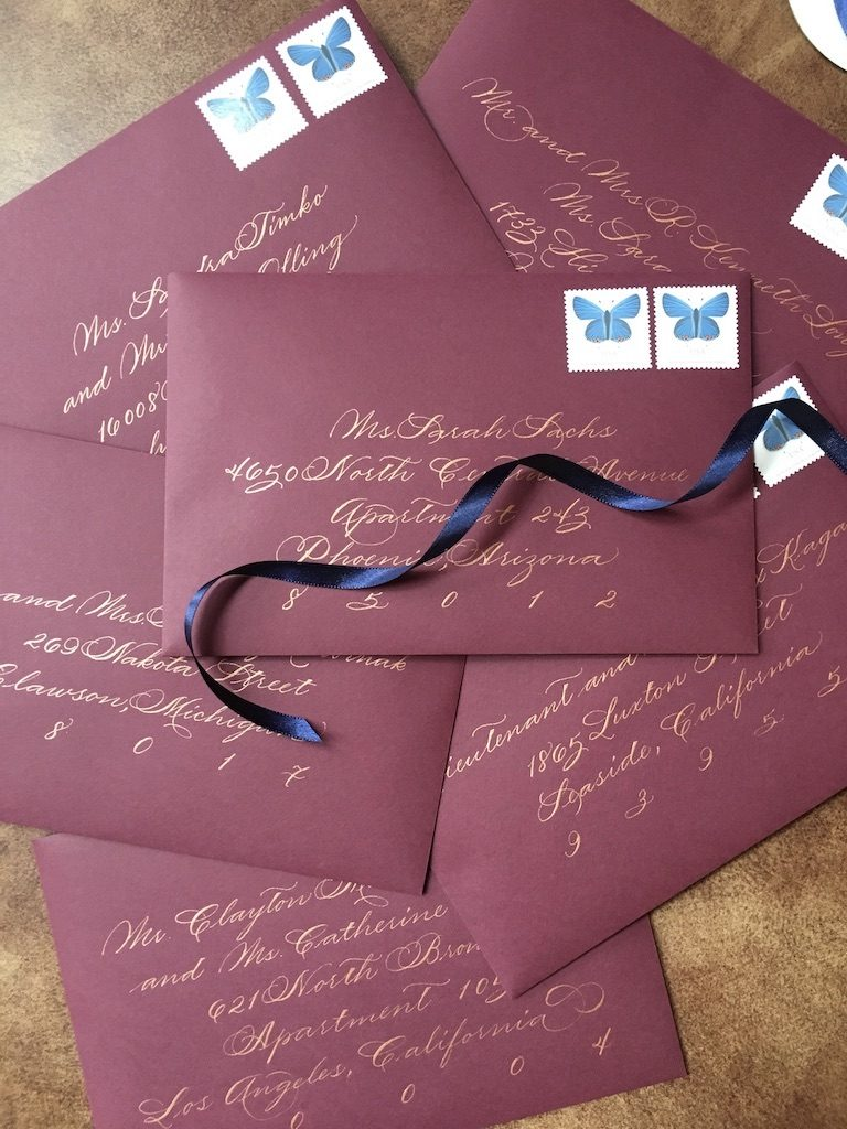 Burgundy envelopes with rose gold calligraphy - Leah E. Moss Designs
