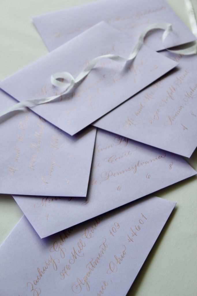 lavender envelopes with rose gold calligraphy - Leah E. Moss Designs