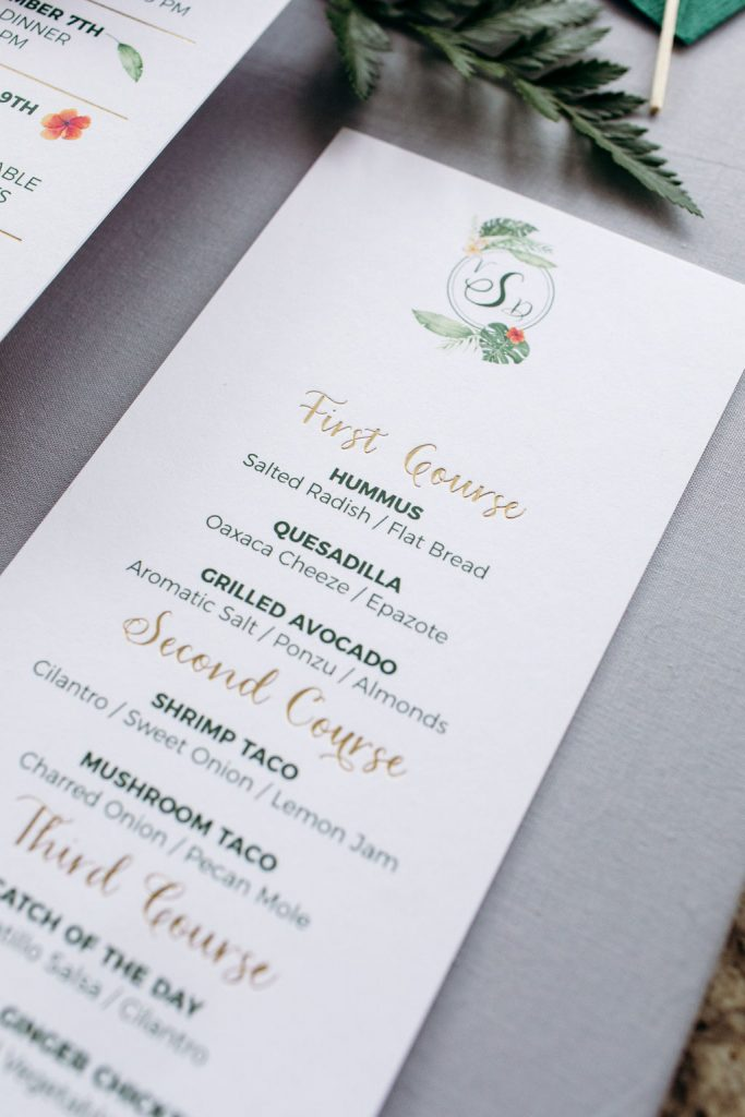 Green tropical wedding menu with gold and watercolor leaf accents - Leah E. Moss Designs