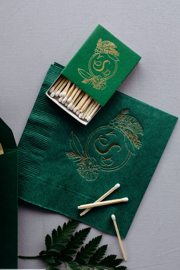 Green and gold foil stamped wedding cocktail napkins and matches - Leah E. Moss Designs