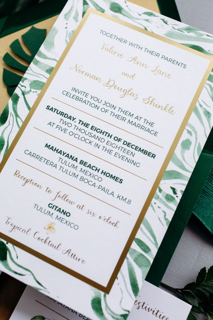 Green tropical wedding invitation with gold and watercolor leaf accents - Leah E. Moss Designs