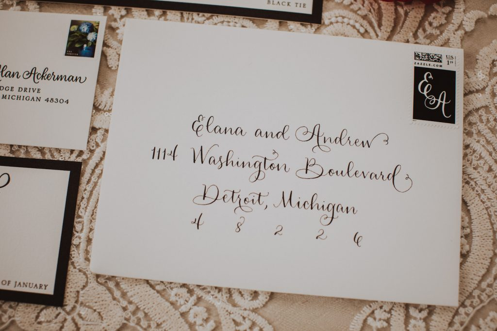Calligraphy envelope - An Elegant Book Cadillac Wedding in black, gold, pink, and white - Leah E. Moss Designs