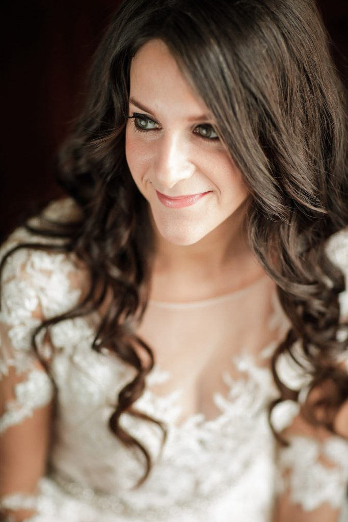 Brunette bridal portrait - An Elegant Book Cadillac Wedding in black, gold, pink, and white - Leah E. Moss Designs