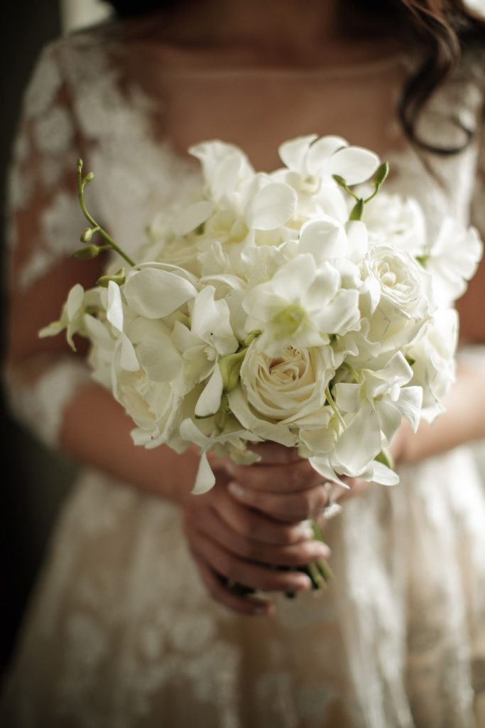 White bridal bouquet - An Elegant Book Cadillac Wedding in black, gold, pink, and white - Leah E. Moss Designs
