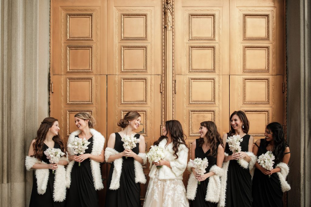 Bridesmaids with scarves for winter wedding - An Elegant Book Cadillac Wedding in black, gold, pink, and white - Leah E. Moss Designs