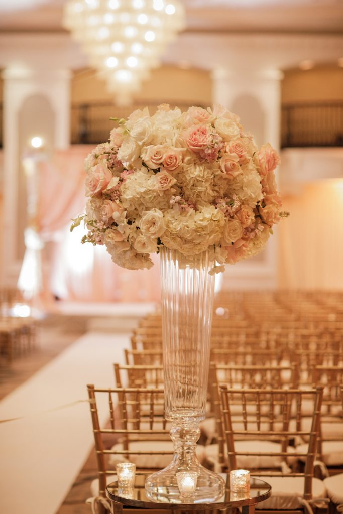 White and blush pink ceremony flowers with gold chairs - An Elegant Book Cadillac Wedding in black, gold, pink, and white - Leah E. Moss Designs