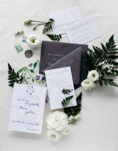 Wedding invitations with modern calligraphy, purple foil stamping, grey letterpress, watercolor floral design - Leah E. Moss Designs