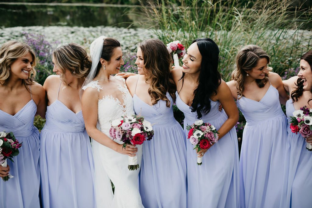 Bridesmaids and bride - Purple and pink florals for wedding at Oakland Hills Country Club in Bloomfield Hills, Michigan - Leah E. Moss Designs