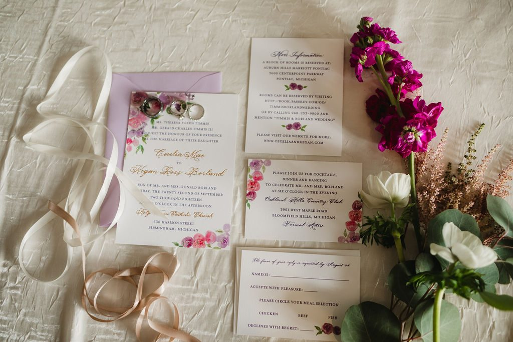 Invitation flatlay - Purple and pink florals for wedding at Oakland Hills Country Club in Bloomfield Hills, Michigan - Leah E. Moss Designs