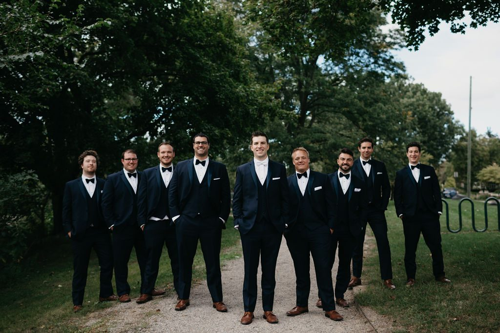 Groom and groomsmen - Purple and pink florals for wedding at Oakland Hills Country Club in Bloomfield Hills, Michigan - Leah E. Moss Designs
