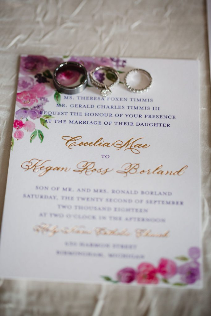Invitation with wedding ring - Purple and pink florals for wedding at Oakland Hills Country Club in Bloomfield Hills, Michigan - Leah E. Moss Designs