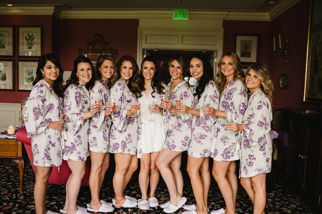 Bridesmaids in robes on wedding day - Purple and pink florals for wedding at Oakland Hills Country Club in Bloomfield Hills, Michigan - Leah E. Moss Designs