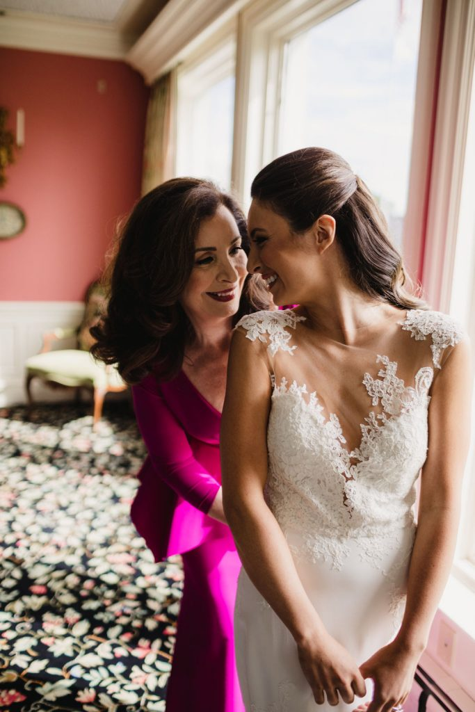 Mom and daughter on wedding day - Purple and pink florals for wedding at Oakland Hills Country Club in Bloomfield Hills, Michigan - Leah E. Moss Designs