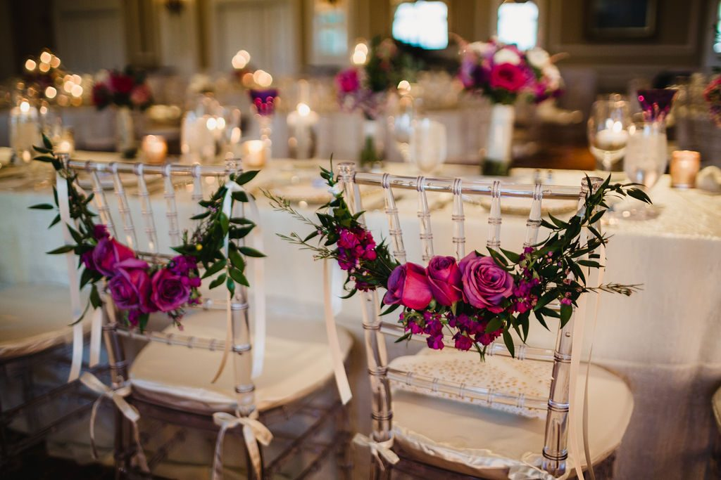 Chair florals - Purple and pink florals for wedding at Oakland Hills Country Club in Bloomfield Hills, Michigan - Leah E. Moss Designs