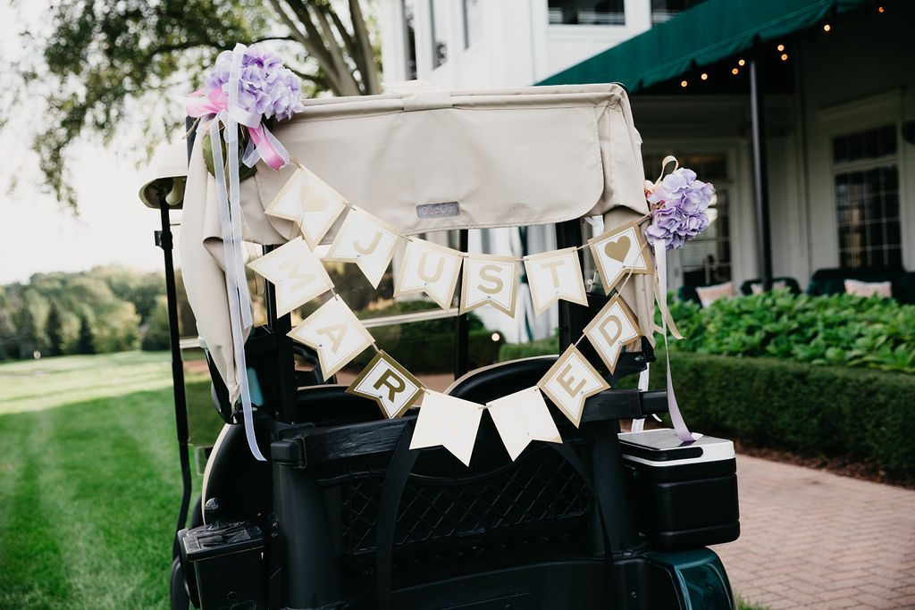 Just married golf cart - Purple and pink florals for wedding at Oakland Hills Country Club in Bloomfield Hills, Michigan - Leah E. Moss Designs