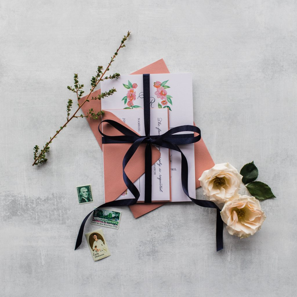 Leah E Moss Designs - the core values of my business - blush invitation with ribbon and vintage stamps