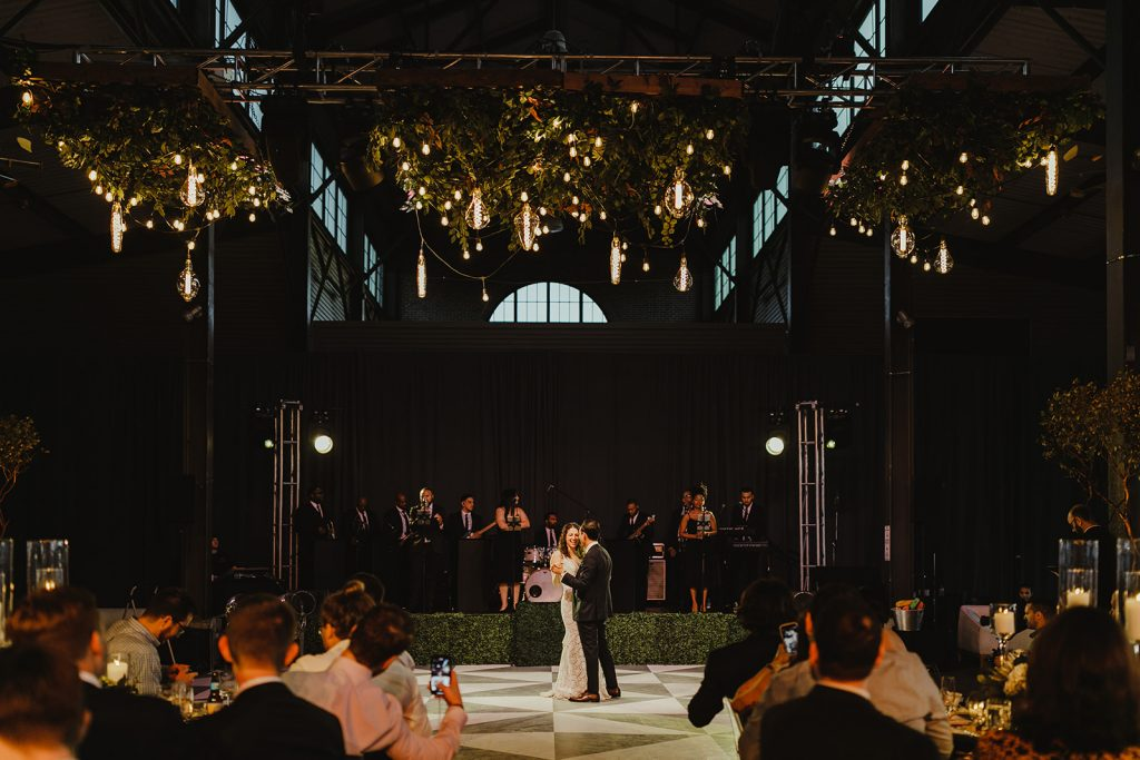 Bride and groom on dance floor - Eastern Market wedding recap from Detroit calligrapher Leah E. Moss Designs with photos by Jill DeVries Photography #detroitwedding #moderncalligraphy #custominvitation