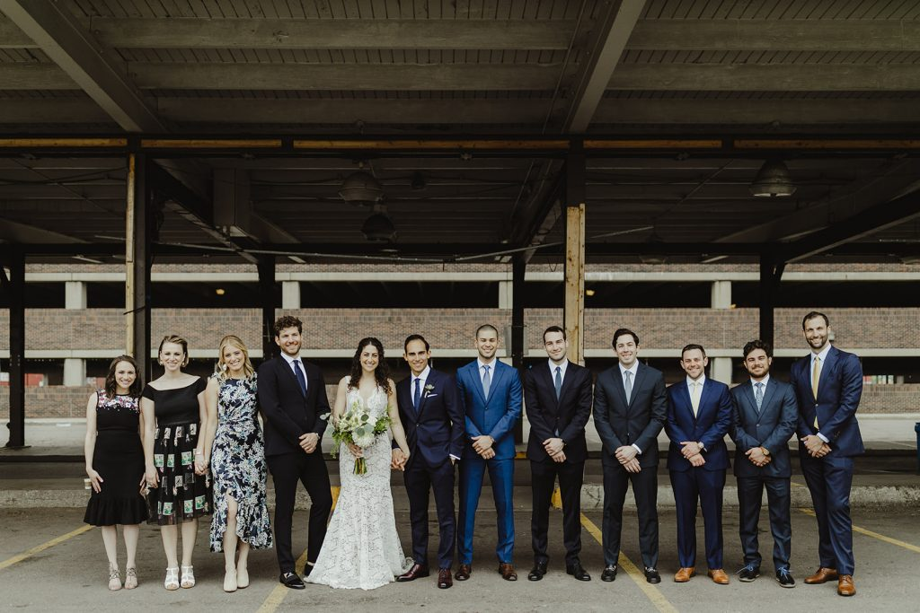 Bridall party in Eastern Market - Eastern Market wedding recap from Detroit calligrapher Leah E. Moss Designs with photos by Jill DeVries Photography #detroitwedding #moderncalligraphy #custominvitation