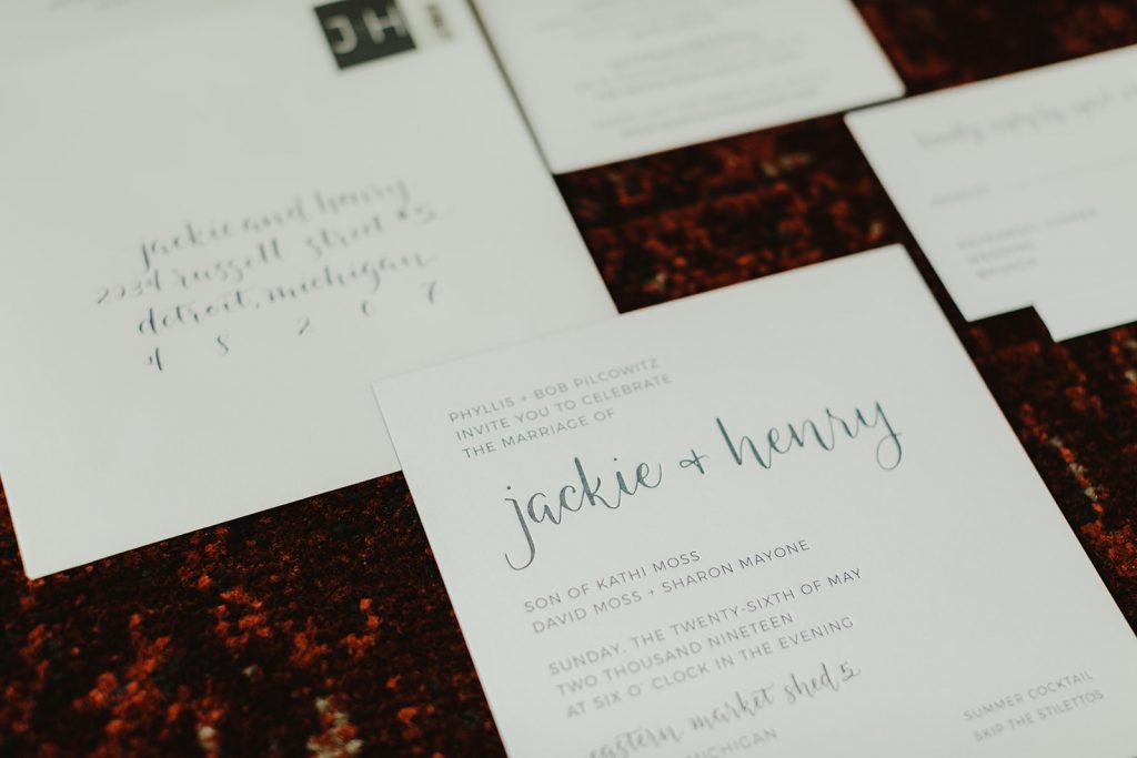 Letterpress and modern calligraphy for wedding invitation - Eastern Market wedding recap from Detroit calligrapher Leah E. Moss Designs with photos by Jill DeVries Photography #detroitwedding #moderncalligraphy #custominvitation