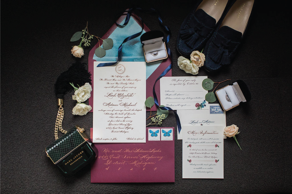 Classic wedding invitation with rose gold foil stamping and burgundy envelope from Michigan calligrapher Leah E. Moss Designs - Michigan wedding invitations