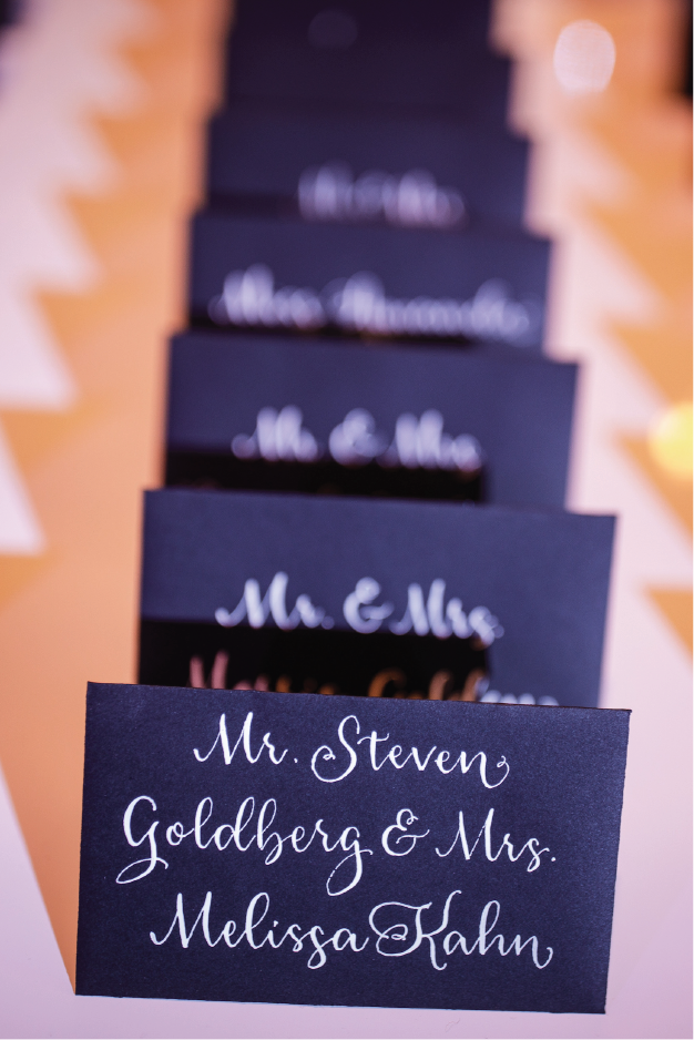 Escort cards in modern calligraphy from Michigan calligrapher Leah E. Moss Designs