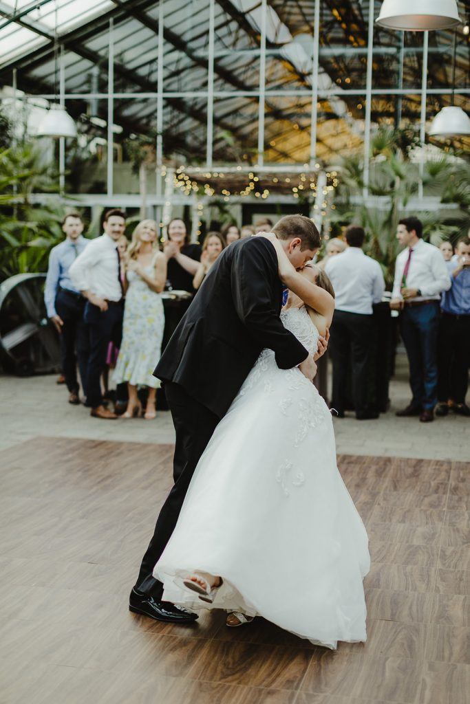 Bride and groom's first dance - Elegant Planterra Conservatory wedding. Highlights from Leah E. Moss Designs. Photos by Jill DeVries Photography. #michiganwedding #greenhousewedding #elegantwedding