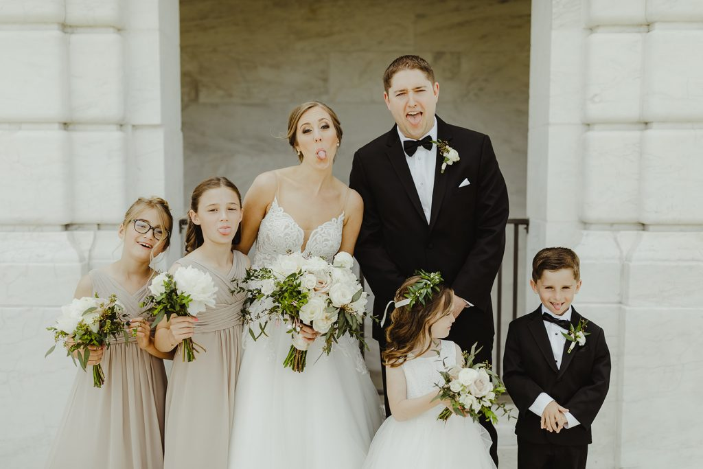 Bride and groom with flower girl and ring bearer - Elegant Planterra Conservatory wedding. Highlights from Leah E. Moss Designs. Photos by Jill DeVries Photography. #michiganwedding #greenhousewedding #elegantwedding