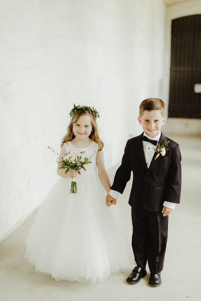 Flower girl and ring bearer - Elegant Planterra Conservatory wedding. Highlights from Leah E. Moss Designs. Photos by Jill DeVries Photography. #michiganwedding #greenhousewedding #elegantwedding