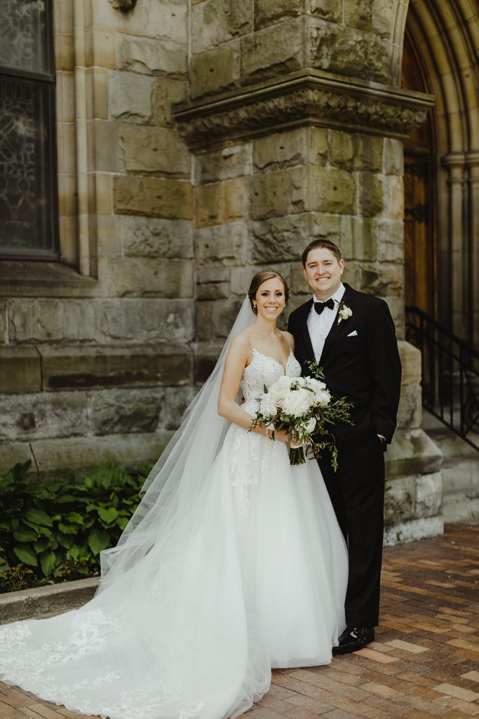 Bride and groom church portrait - Elegant Planterra Conservatory wedding. Highlights from Leah E. Moss Designs. Photos by Jill DeVries Photography. #michiganwedding #greenhousewedding #elegantwedding