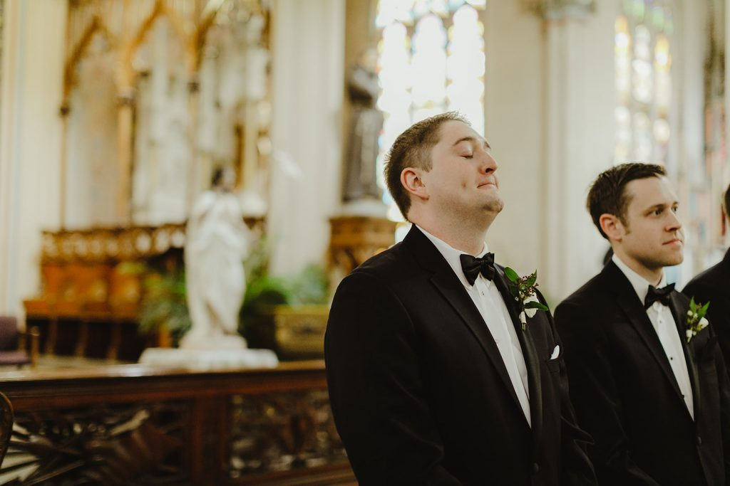 Groom in tears seeing bride walk down the aisle - Elegant Planterra Conservatory wedding. Highlights from Leah E. Moss Designs. Photos by Jill DeVries Photography. #michiganwedding #greenhousewedding #elegantwedding