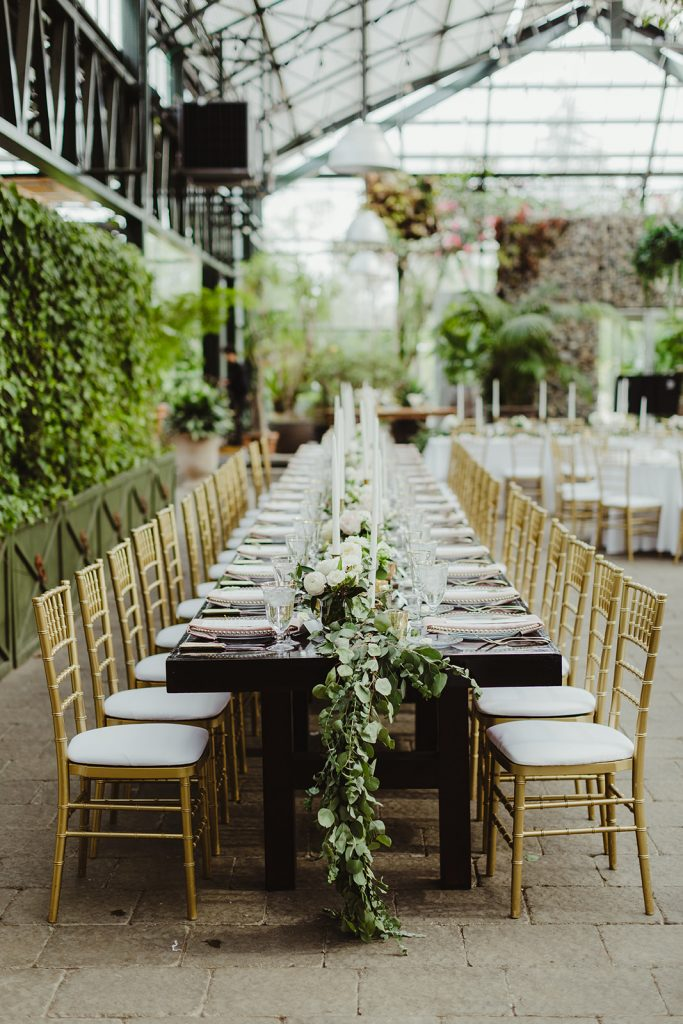 Long table - Elegant Planterra Conservatory wedding. Highlights from Leah E. Moss Designs. Photos by Jill DeVries Photography. #michiganwedding #greenhousewedding #elegantwedding