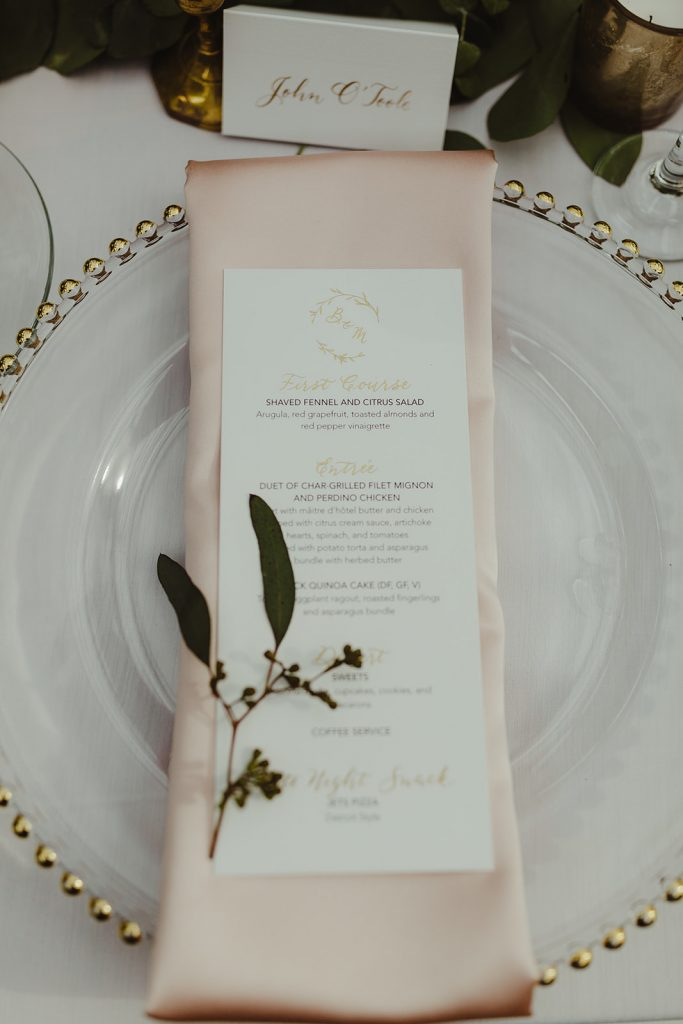 Menu with gold foil stamping - Elegant Planterra Conservatory wedding. Highlights from Leah E. Moss Designs. Photos by Jill DeVries Photography. #michiganwedding #greenhousewedding #elegantwedding