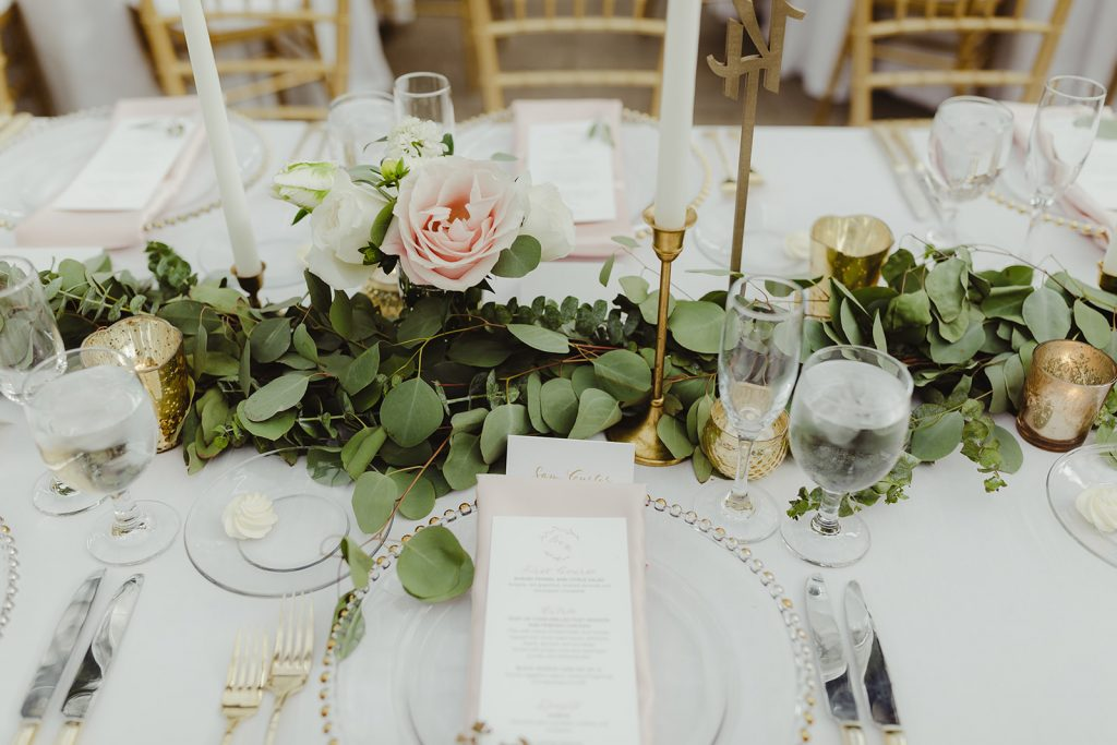 Tabletop with garland - Elegant Planterra Conservatory wedding. Highlights from Leah E. Moss Designs. Photos by Jill DeVries Photography. #michiganwedding #greenhousewedding #elegantwedding