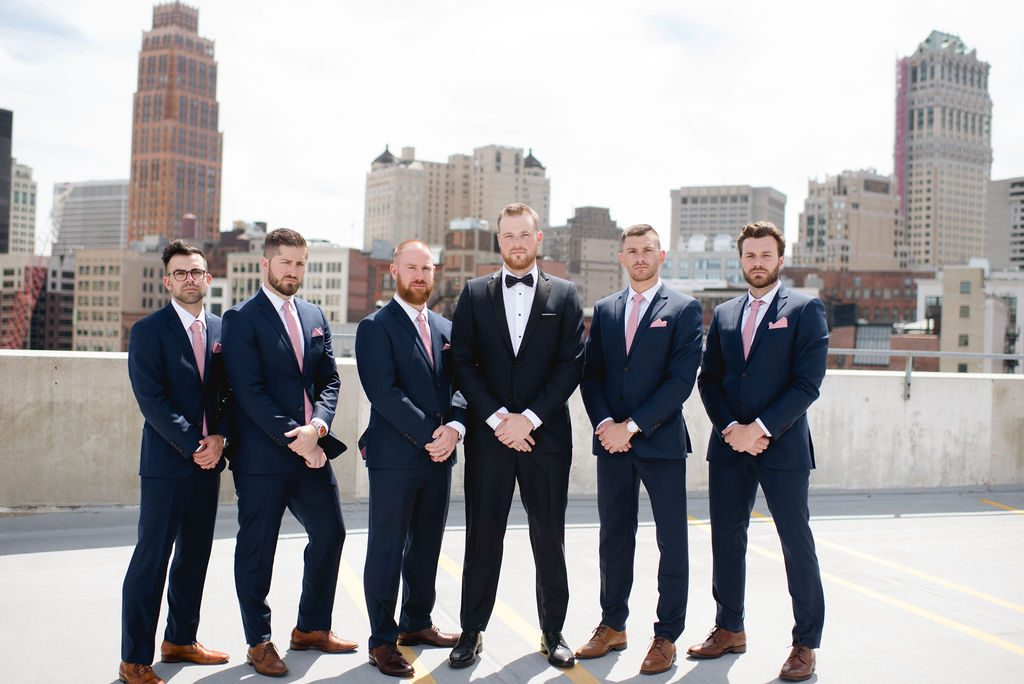 Groomsmen and groom - Classic and Neutral Wedding at the Garden Theater in Detroit, Michigan - Recap by wedding invitations designer Leah E. Moss Designs with photos by Niki Marie Photography