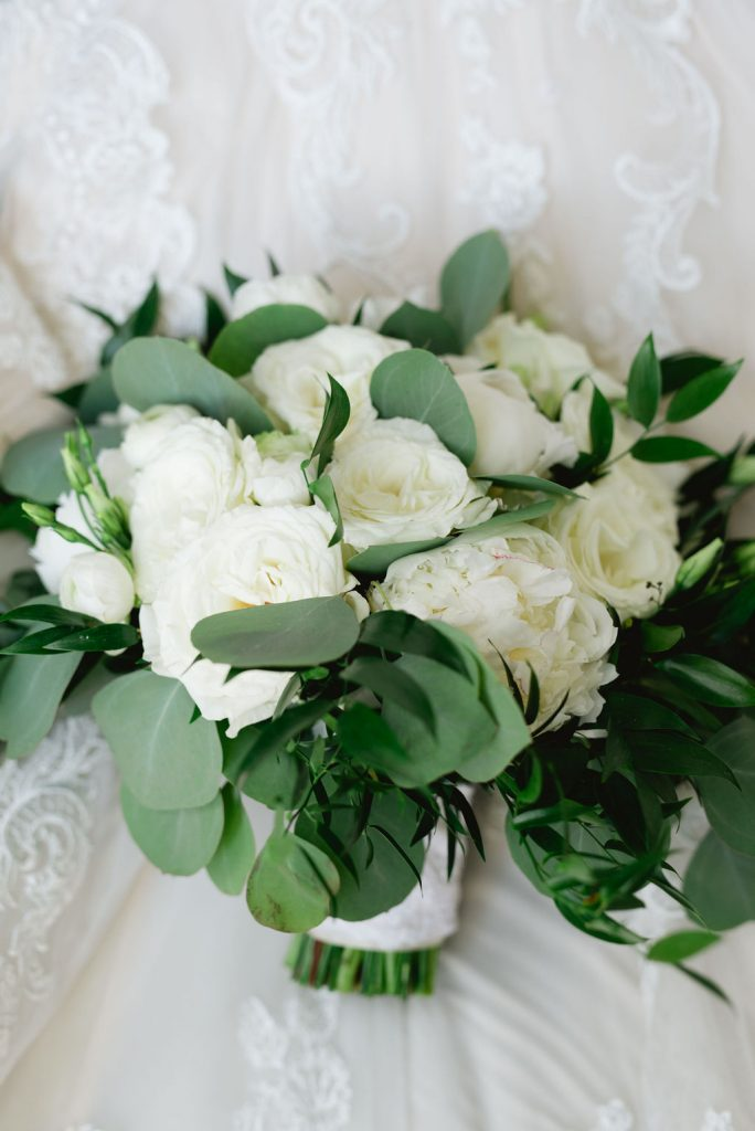 White bouquet for bride with greenery - Classic and Neutral Wedding at the Garden Theater in Detroit, Michigan - Recap by wedding invitations designer Leah E. Moss Designs with photos by Niki Marie Photography