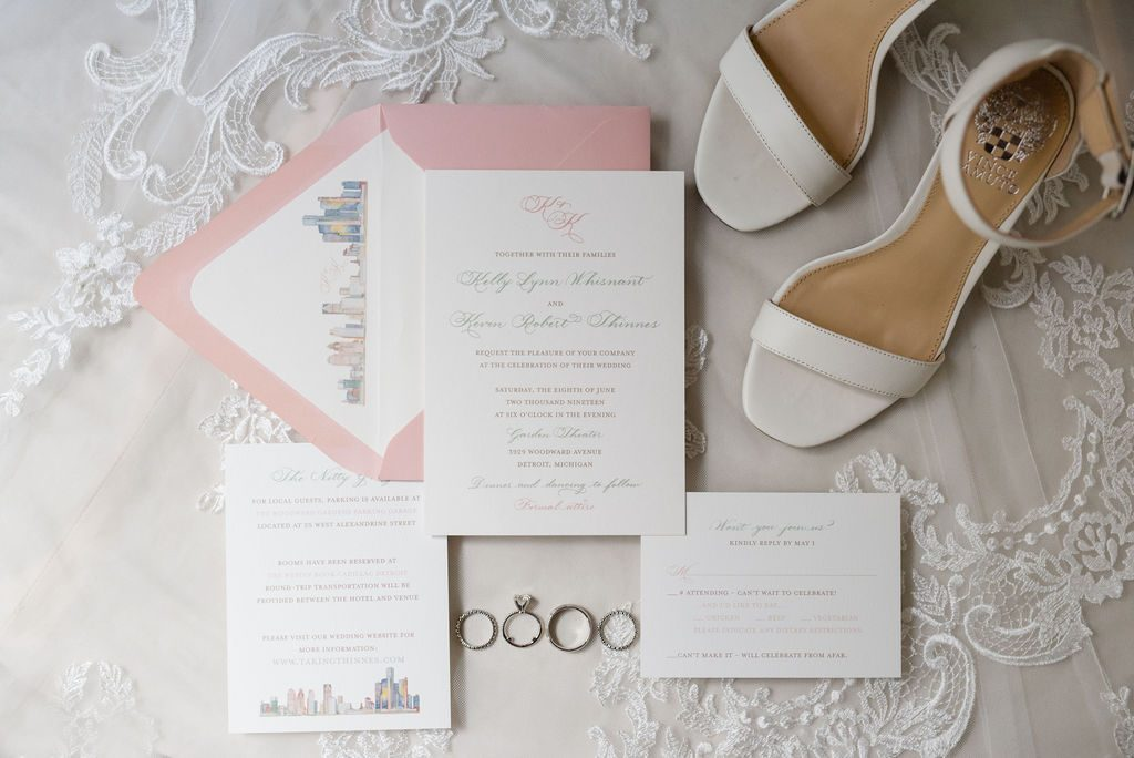 Wedding invitation with Detroit skyline watercolor and Vince Camuto white wedding shoes - Classic and Neutral Wedding at the Garden Theater in Detroit, Michigan - Recap by wedding invitations designer Leah E. Moss Designs with photos by Niki Marie Photography
