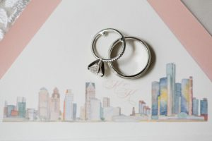 Wedding ring with Detroit skyline custom watercolor illustration for envelope liner on wedding invitation - Classic and Neutral Wedding at the Garden Theater in Detroit, Michigan - Recap by wedding invitations designer Leah E. Moss Designs with photos by Niki Marie Photography