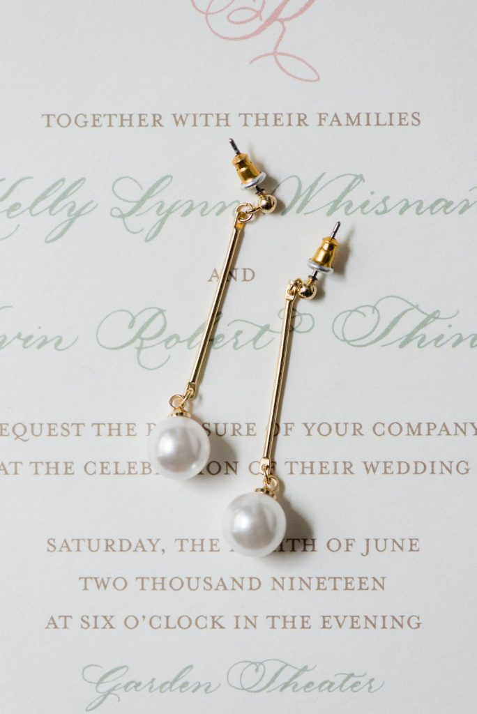 Drop Pearl Earrings for bride with invitation - Classic and Neutral Wedding at the Garden Theater in Detroit, Michigan - Recap by wedding invitations designer Leah E. Moss Designs with photos by Niki Marie Photography