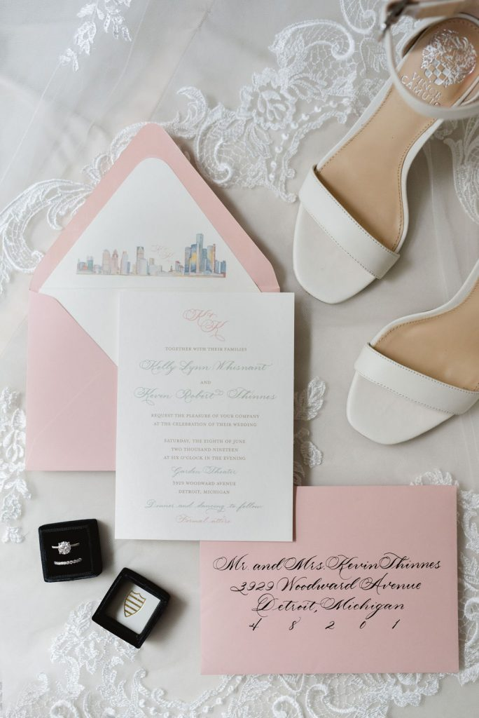 Wedding invitation with calligraphy and pink envelope with watercolor illustration - Classic and Neutral Wedding at the Garden Theater in Detroit, Michigan - Recap by wedding invitations designer Leah E. Moss Designs with photos by Niki Marie Photography