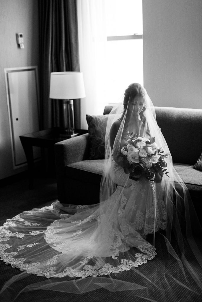 Black and white bridal portrait with veil - Classic and Neutral Wedding at the Garden Theater in Detroit, Michigan - Recap by wedding invitations designer Leah E. Moss Designs with photos by Niki Marie Photography