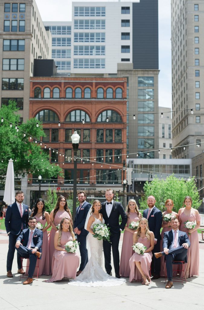 Wedding party in Detroit park with skyline - Classic and Neutral Wedding at the Garden Theater in Detroit, Michigan - Recap by wedding invitations designer Leah E. Moss Designs with photos by Niki Marie Photography